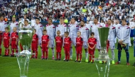 CARDIFF, WALES - Tuesday, August 12, 2014: Real Madrid players line up in front of the European Champions Cup and the UEFA Cup (Europa League) ahead of the UEFA Super Cup at the Cardiff City Stadium. (Pic by David Rawcliffe/Propaganda)