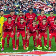 CARDIFF, WALES - Tuesday, August 12, 2014: Sevilla players line up for a team group photograph before the UEFA Super Cup at the Cardiff City Stadium. Back row L-R: goalkeeper Beto, Daniel Carrico, Nicolas Pareja, Federico Fazio, Grzegorz Krychowiak, Vitolo. Front row L-R: Sebastian Cristoforo, Aleix Vidal Parreu, Fernando Navarro, Denis Suarez, Coke. (Pic by David Rawcliffe/Propaganda)