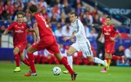 CARDIFF, WALES - Tuesday, August 12, 2014: Real Madrid's Gareth Bale in action against Sevilla during the UEFA Super Cup at the Cardiff City Stadium. (Pic by David Rawcliffe/Propaganda)