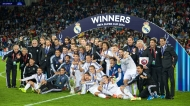 CARDIFF, WALES - Tuesday, August 12, 2014: Real Madrid's celebrate with the trophy after their 2-0 victory over Sevilla during the UEFA Super Cup at the Cardiff City Stadium. Cristiano Ronaldo, Gareth Bale, goalkeeper Iker Casillas, Isco, Sergio Ramos, head coach Carlo Ancelotti. (Pic by David Rawcliffe/Propaganda)